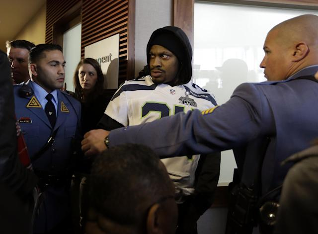 Seattle Seahawks running back Marshawn Lynch arrives for a media availability escorted by members of the New Jersey State Police Thursday, Jan. 30, 2014, in Jersey City, N.J. The Seahawks and the Denver Broncos are scheduled to play in the Super Bowl XLVIII football game Sunday, Feb. 2, 2014. (AP Photo)