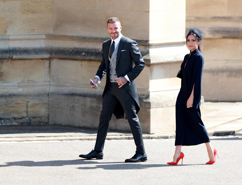 British fashion designer Victoria Beckham and her husband, British former soccer player David Beckham arrive for the royal wedding ceremony of Britain's Prince Harry and Meghan Markle at St George's Chapel in Windsor Castle, in Windsor, Britain, 19 May 2018. LAUREN HURLEY/Pool via REUTERS