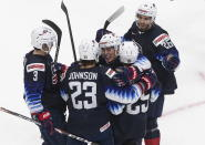 United States' Henry Thrun (3), Ryan Johnson (23), Brett Berard (21), John Farinacci (25) and Landon Slaggert (26) celebrate a goal against Slovakia during the second period of an IIHL World Junior Hockey Championship game, Saturday, Jan. 2, 2021 in Edmonton, Alberta. (Jason Franson/The Canadian Press via AP)