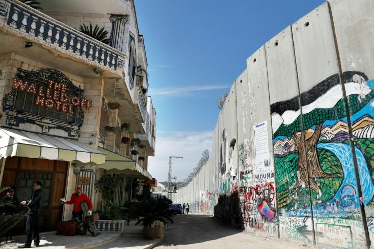 Street artist Banksy opened the Walled-Off Hotel next to Israel's controversial separation wall in Bethlehem on March 3