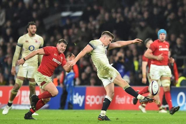 England's centre Owen Farrell kicks the ball into touch as the last kick of the game during their Six Nations rugby union match against Wales, at the Twickenham in west London, on February 10, 2018