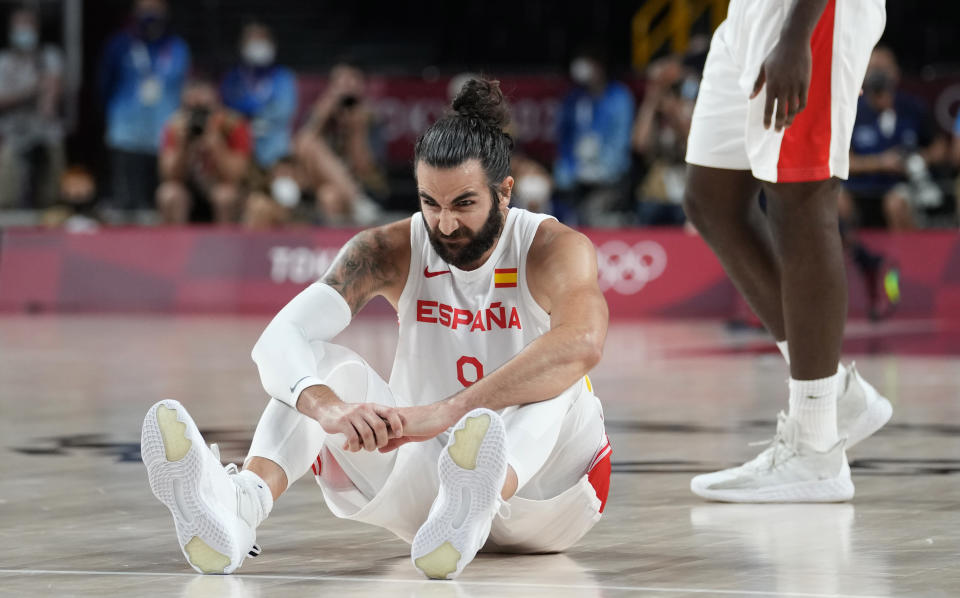 Spain's Ricky Rubio (9) reacts after he fell on the court during men's basketball quarterfinal game against United States of America at the 2020 Summer Olympics, Tuesday, Aug. 3, 2021, in Saitama, Japan. (AP Photo/Eric Gay)
