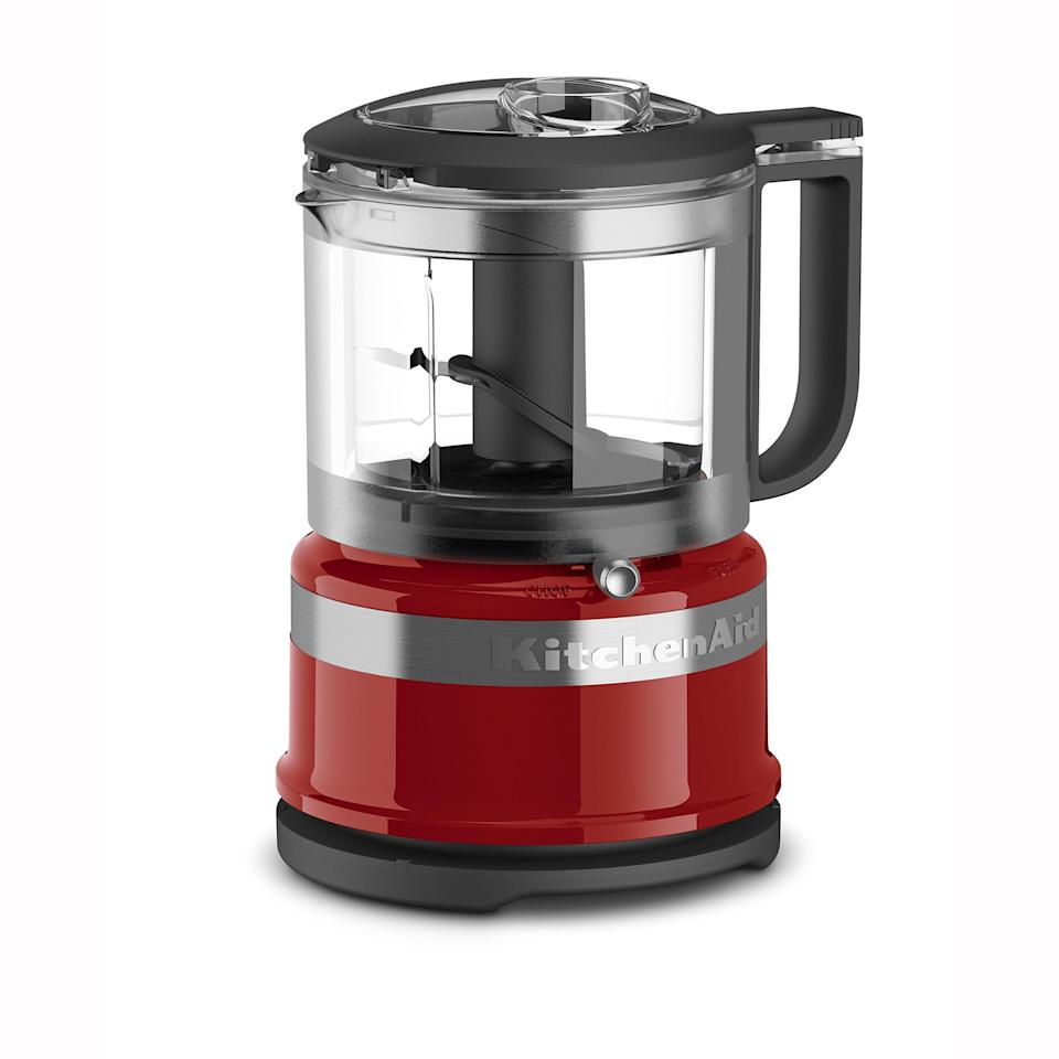 """<p><strong>KitchenAid</strong></p><p>walmart.com</p><p><strong>$49.99</strong></p><p><a href=""""https://go.redirectingat.com?id=74968X1596630&url=https%3A%2F%2Fwww.walmart.com%2Fip%2F560717987&sref=https%3A%2F%2Fwww.thepioneerwoman.com%2Ffood-cooking%2Fcooking-tips-tutorials%2Fg36560906%2Fbest-food-choppers%2F"""" rel=""""nofollow noopener"""" target=""""_blank"""" data-ylk=""""slk:Shop Now"""" class=""""link rapid-noclick-resp"""">Shop Now</a></p><p>Looking for a food chopper with a little bit more power? This KitchenAid device is electric, so all you have to do is press a button. It's more versatile, as you can also incorporate liquid ingredients to make sauces or dressings.</p>"""