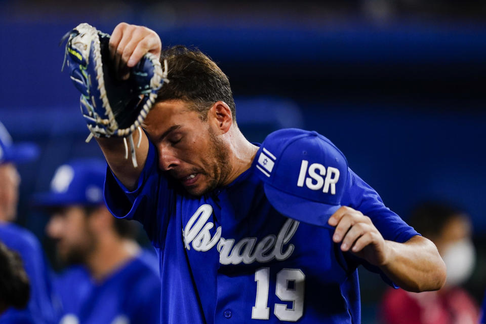 Israel's Danny Valencia wipes his face after a baseball game against the Dominican Republic at the 2020 Summer Olympics, Tuesday, Aug. 3, 2021, in Yokohama, Japan. The Dominican Republic won 7-6. (AP Photo/Matt Slocum)