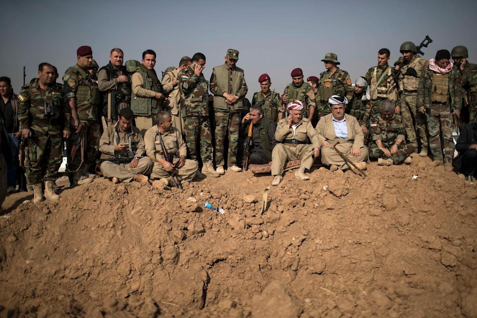 Kurdish Peshmerga fighters and commanders overlook Islamic State group positions during heavy fighting in Bashiqa, east of Mosul, Iraq, on Nov. 7, 2016.