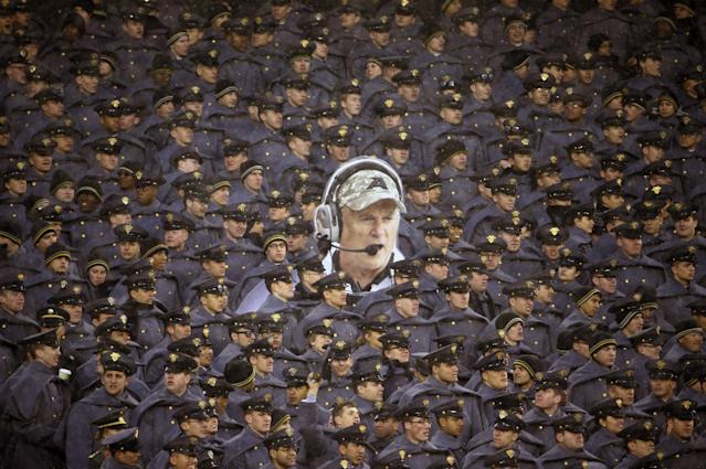 Army cadets hold a large photo of Army head coach Rich Ellerson during an NCAA college football game against Navy, Saturday, Dec. 14, 2013, in Philadelphia. Navy won 34-7. (AP Photo/Matt Slocum)