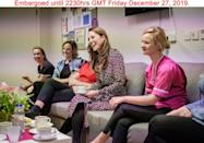 """<p><a href=""""https://www.townandcountrymag.com/society/tradition/a30345251/kate-middleton-midwives-open-letter-photos/"""" rel=""""nofollow noopener"""" target=""""_blank"""" data-ylk=""""slk:Kate Middleton secretly visited Kingston Hospital's Maternity Unit"""" class=""""link rapid-noclick-resp"""">Kate Middleton secretly visited Kingston Hospital's Maternity Unit </a>earlier this year, and Kensington Palace released the photos shortly after Christmas. For the event, Kate chose a printed dress and black tights.</p>"""