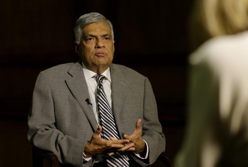 Sri Lankan Prime Minister Ranil Wickremesinghe takes a question during an interview with the Associated Press at his office in Colombo, Sri Lanka, Thursday, April 25, 2019. Wickremesinghe has acknowledged to The Associated Press that minority Ahmadi Muslims who are refugees from Pakistan have faced attacks since the Easter bombings. He said Thursday that security forces were trying to help the Ahmadis. (AP Photo/Eranga Jayawardena)