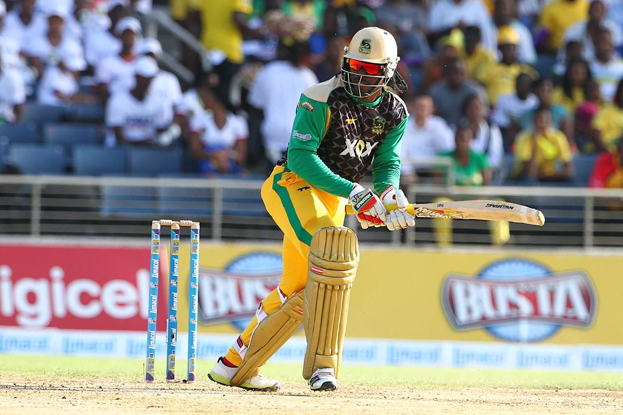 KINGSTON, JAMAICA - AUGUST 15: Chris Gayle plays the ball for a single during the Sixteenth Match of the Cricket Caribbean Premier League between Jamaica Tallawahs v Guyana Amazon Warriors at Sabina Park on August 15, 2013 in Kingston, Jamaica. (Photo by Ashley Allen/Getty Images Latin America for CPL)