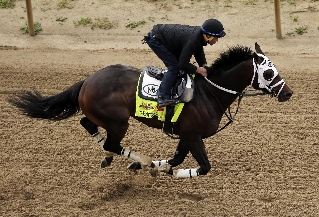 Exercise rider Joel Barrientos takes Kentucky Derby hopeful General a Rod for a morning workout at Churchill Downs Tuesday, April 29, 2014, in Louisville, Ky. (AP Photo/Charlie Riedel)