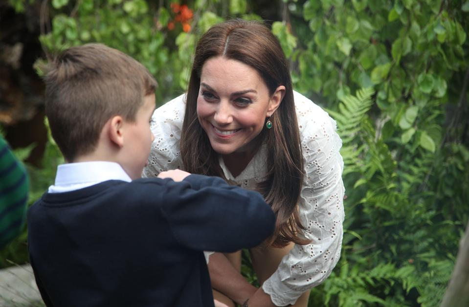 The Duchess of Cambridge speaks to children during a visit to her garden at the RHS Chelsea Flower Show at the Royal Hospital Chelsea, London [Photo: PA]