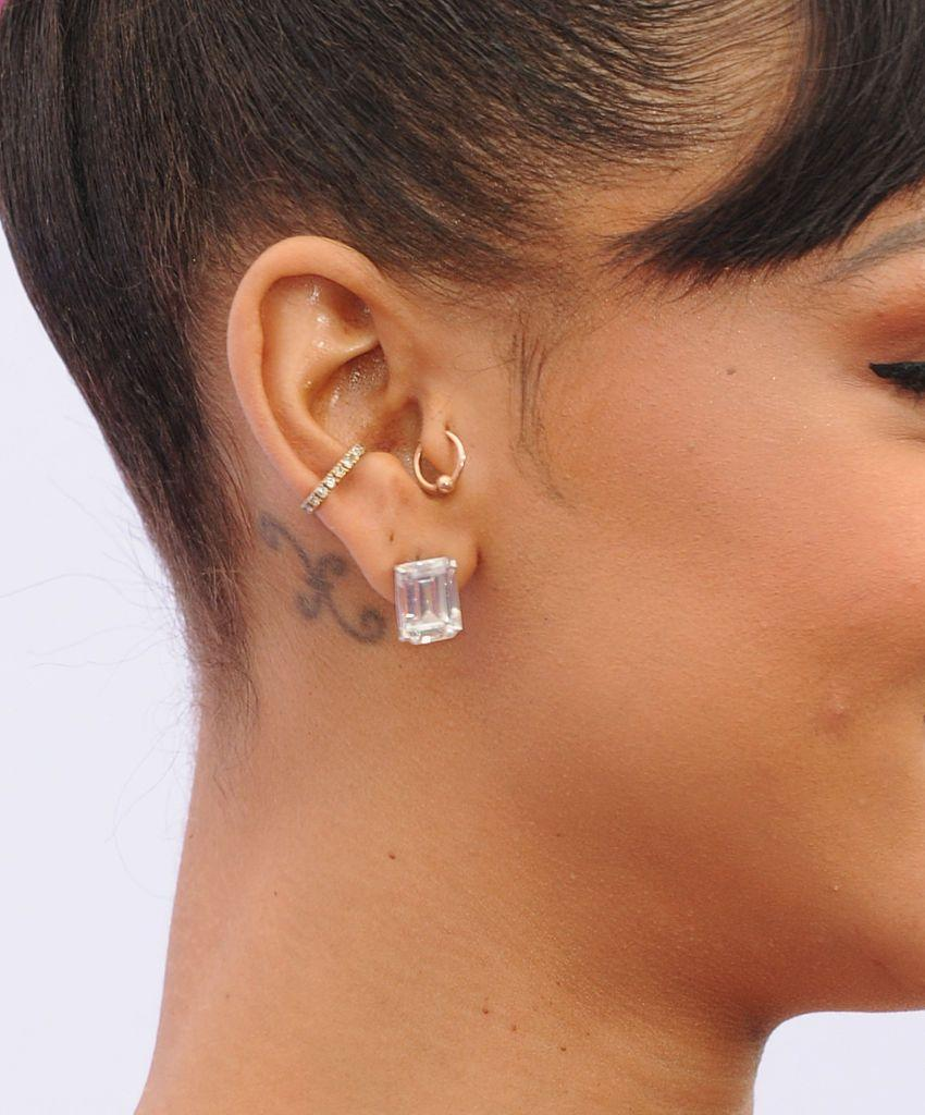 <p>Behind her right ear, Rihanna has her starsign symbol for Pieces tattooed.</p>