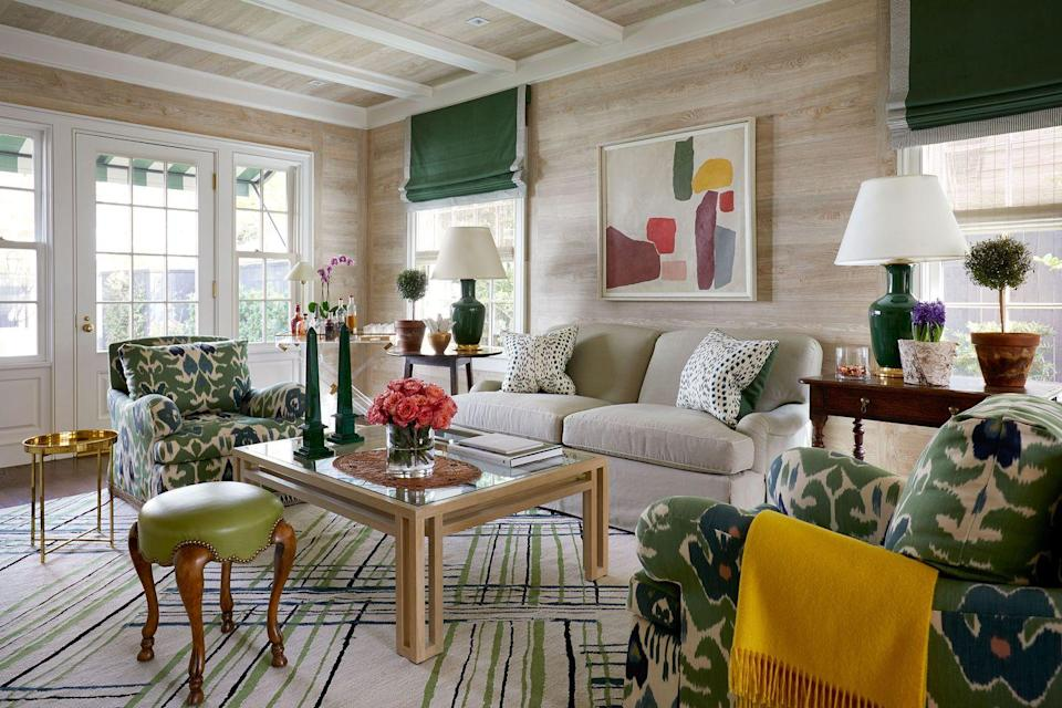 """<p>Houston-based <a href=""""https://www.elledecor.com/design-decorate/interior-designers/g3076/a-list-interior-designers/"""" rel=""""nofollow noopener"""" target=""""_blank"""" data-ylk=""""slk:A-List"""" class=""""link rapid-noclick-resp"""">A-List</a> designer <a href=""""http://www.jrandallpowers.com/"""" rel=""""nofollow noopener"""" target=""""_blank"""" data-ylk=""""slk:J."""" class=""""link rapid-noclick-resp""""><strong>J.</strong> </a><strong><a href=""""http://www.jrandallpowers.com/"""" rel=""""nofollow noopener"""" target=""""_blank"""" data-ylk=""""slk:Randall Powers"""" class=""""link rapid-noclick-resp"""">Randall Powers</a> </strong>concurs. """"While neutral tones always seem to play most popular, I have seen a big move and nods of 'yes, please' to stronger colors and pattern play, almost as if <a href=""""https://www.elledecor.com/design-decorate/interior-designers/a23839075/designers-remember-mario-buatta-prince-of-chintz/"""" rel=""""nofollow noopener"""" target=""""_blank"""" data-ylk=""""slk:Mario Buatta"""" class=""""link rapid-noclick-resp"""">Mario Buatta</a> is getting his last laugh."""" As we bid farewell to 2020, Powers believes greens are definitely on the rise, along with a mix of antiques with newly minted pieces. """"I can confidently say that brown wood is back with a vengeance,"""" he says. """"As are wicker and rattan.""""</p>"""