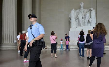 A US Parks Policeman walks among tourists flocking to the Lincoln Memorial, in Washington, September 29, 2013, as a possible government shutdown looms in two days. REUTERS/Mike Theiler