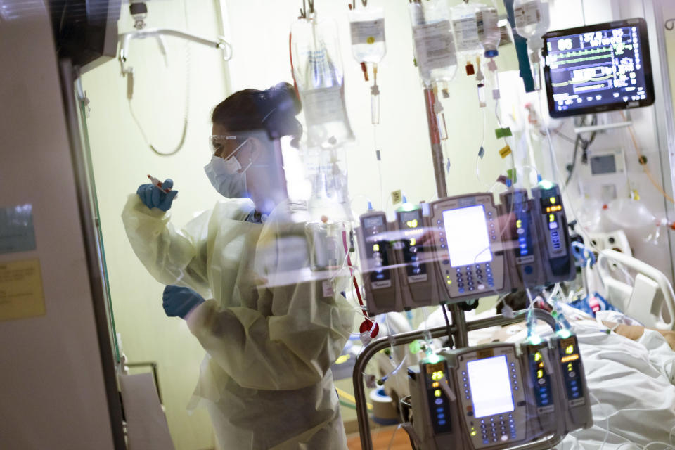 """FILE - In this Tuesday, Aug. 31, 2021 file photo Ann Enderle R.N. attends to a COVID-19 patient in the Medical Intensive care unit (MICU) at St. Luke's Boise Medical Center in Boise, Idaho. Idaho's public health officials say crisis standards of care are """"imminent"""" for the state's most populated region as hospitals in the Boise area continue to be overrun with unvaccinated coronavirus patients. Hospitals in the northern half of the state were given permission to begin rationing care last week. (AP Photo/Kyle Green,File)"""