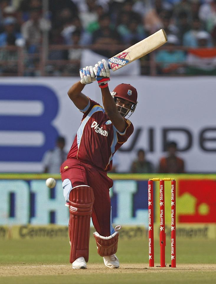 A West Indian batsman in action during the 1st ODI match between India and West Indies at Nehru Stadium in Kochi on Nov.21, 2013. (Photo: IANS)