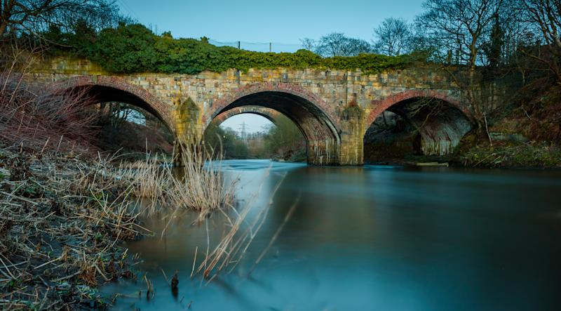 Disused aqueduct that used to carry the Manchester, Bolton and Bury canal over the river Irwell