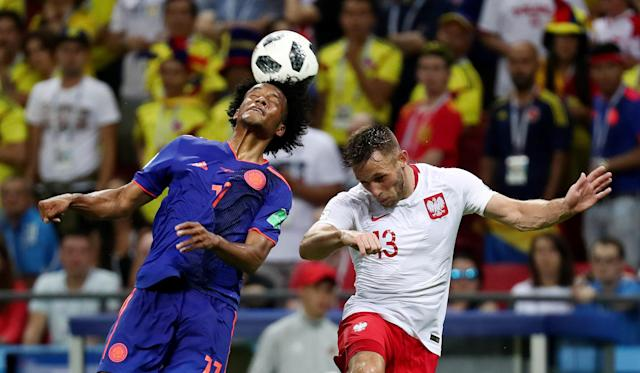 Soccer Football - World Cup - Group H - Poland vs Colombia - Kazan Arena, Kazan, Russia - June 24, 2018 Colombia's Juan Cuadrado in action with Poland's Maciej Rybus REUTERS/Sergio Perez
