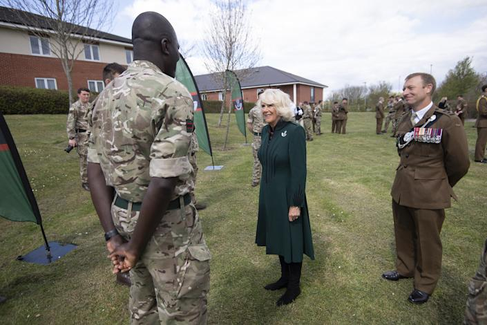 The Duchess of Cornwall meets Colour Sergeant Jerry Wiredu during her first visit to 5th Battalion The Rifles, following her new appointment as Colonel-in-Chief, at Bulford Station in Wiltshire. Picture date: Friday May 7, 2021.