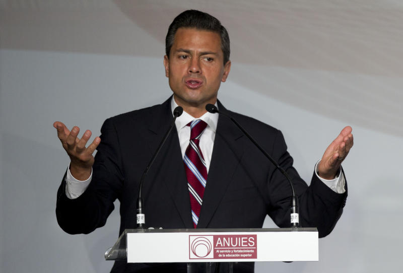 Enrique Pena Nieto, presidential candidate for the Institutional Revolutionary Party (PRI), speaks during a meeting with Mexican universities rectors in Mexico, Monday,  May 21, 2012. Pena Nieto, the front-running candidate in the race for Mexico's July 1 presidential election, is pledging to respect transparency and plurality if elected, things his Institutional Revolutionary Party was not known for during 71 years in power. (AP Photo/Eduardo Verdugo)