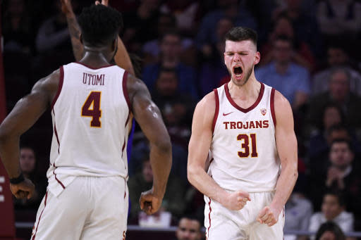 Southern California forward Nick Rakocevic, right, celebrates with guard Daniel Utomi after scoring and drawing a foul during the second half of an NCAA college basketball game against Washington Thursday, Feb. 13, 2020, in Los Angeles. (AP Photo/Mark J. Terrill)