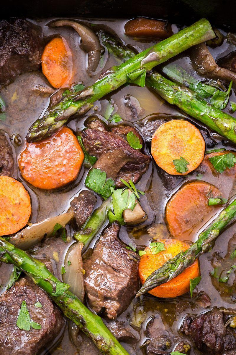 """<p>Add some freshness to the beefy classic with this insanely delish slow cooker dinner.</p><p>Get the <a href=""""https://www.delish.com/uk/cooking/recipes/a28830287/slow-cooker-beef-bourguignon/"""" rel=""""nofollow noopener"""" target=""""_blank"""" data-ylk=""""slk:Slow Cooker Spring Beef Bourguignon"""" class=""""link rapid-noclick-resp"""">Slow Cooker Spring Beef Bourguignon</a> recipe. </p>"""