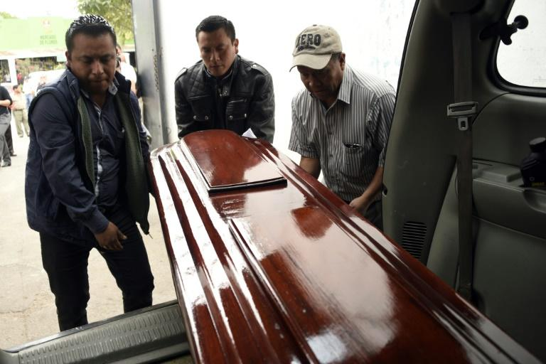 Workers carry the coffin of Keyla Salguero, one of the victims of a fire at a government-run children's shelter in San Jose Pinula, east of Guatemala City