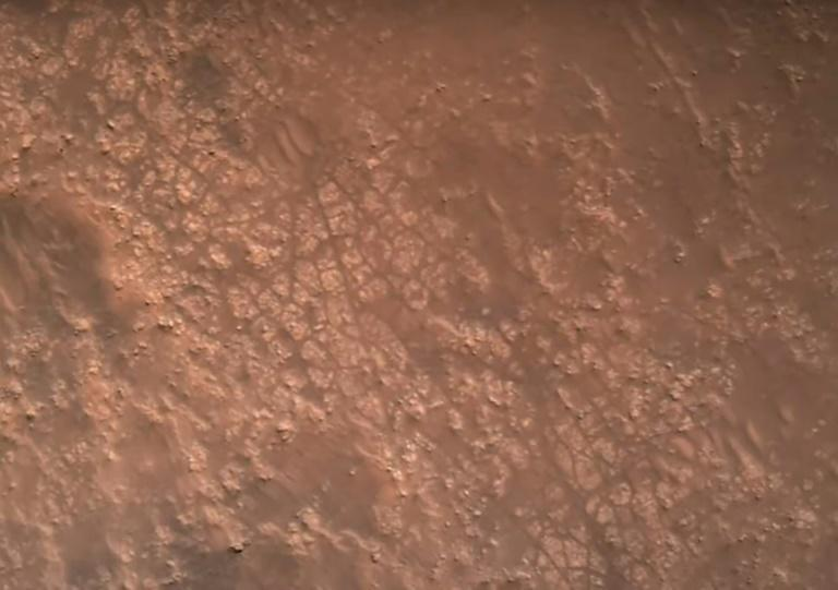 This NASA video frame grab photo released on February 22, 2021 shows the surface of Mars, captured by the Perseverance rover