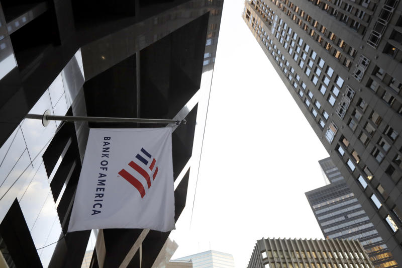 FILE - In this Oct. 14, 2019, file photo photo a Bank of America flag waves in front of the Bank of America Financial Center building, in Boston. Bank of America reports financial results Wednesday, Jan. 15, 2020. (AP Photo/Steven Senne, File)