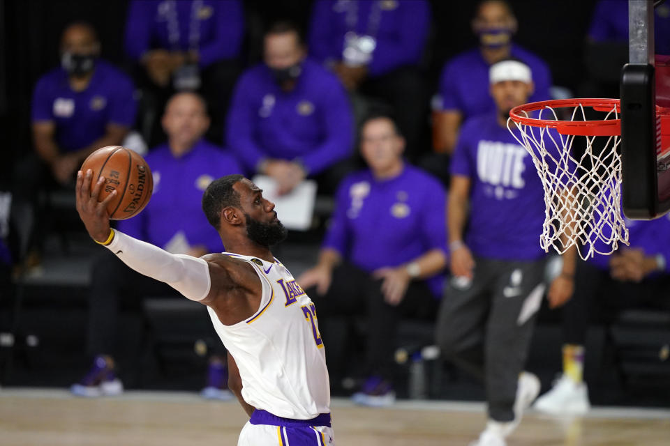 Los Angeles Lakers' LeBron James (23) dunks during the first half in Game 6 of basketball's NBA Finals against the Miami Heat Sunday, Oct. 11, 2020, in Lake Buena Vista, Fla. (AP Photo/Mark J. Terrill)