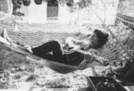 <p>Mick Jagger lies in a hammock and strums a guitar at Stephen Stills' house in Laurel Canyon, California, where the group are rehearsing for their American tour, October 1969.</p>