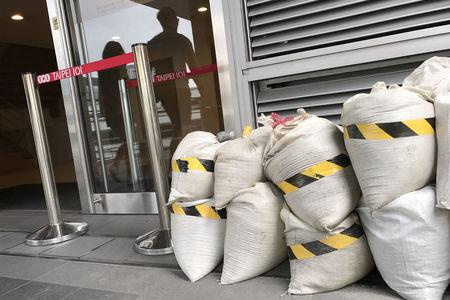 Sandbags are prepared ahead of Typhoon Talim in a landmark building Taipei 101 in Taipei