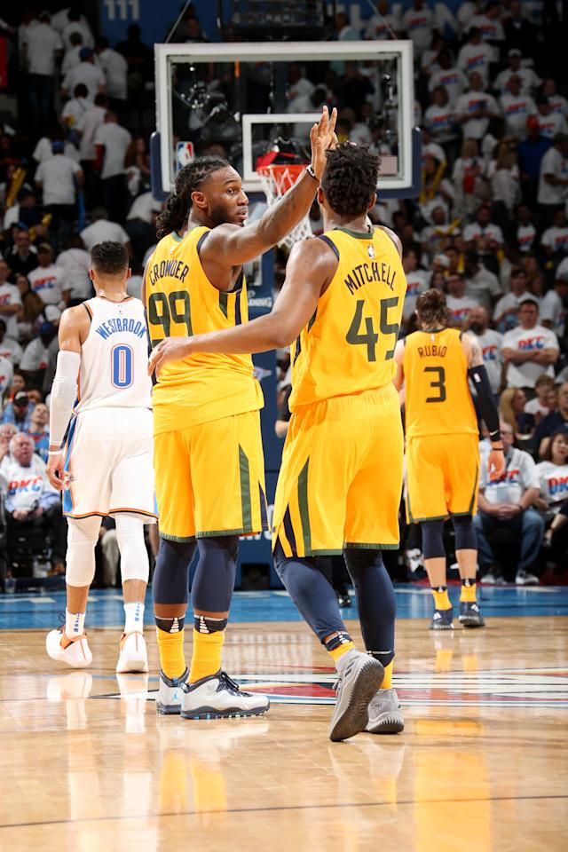 OKLAHOMA CITY, OK - APRIL 18 - Jae Crowder #99 and Donovan Mitchell #45 of the Utah Jazz exchange high fives against the Oklahoma City Thunder in Game Two of Round One of the 2018 NBA Playoffs on April 18 2018 at Chesapeake Energy Arena in Oklahoma City, Oklahoma. (Photo by Layne Murdoch Sr./NBAE via Getty Images)