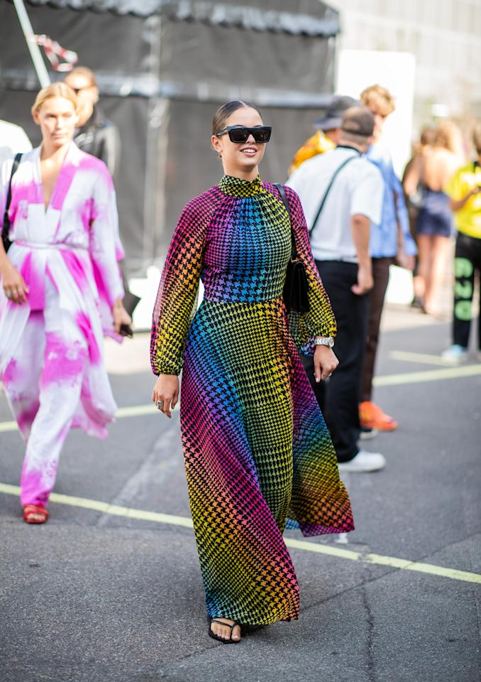 <p>Styling a colorful dress with a simple black pair.</p>