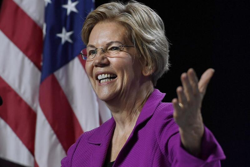 Warren, in NYC rally, casts campaign as successor to other women-led movements
