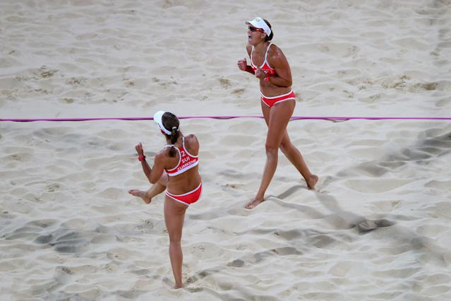 LONDON, ENGLAND - JULY 28: Nadine (L) Zumkehr and Simone Kuhn of Switzerland celebrate a point against Greece during the Women's Beach Volleyball Preliminary Round between Switzerland and Greece on Day 1 of the London 2012 Olympic Games at Horse Guards Parade on July 28, 2012 in London, England. (Photo by Ryan Pierse/Getty Images)