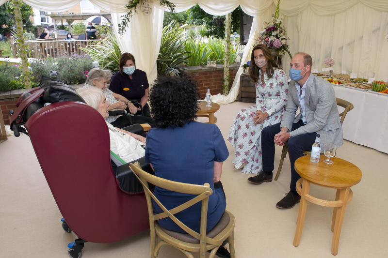 The Duke and Duchess of Cambridge speak with resident Margaret Stocks during their visit to Shire Hall Care Home in Cardiff, South Wales.