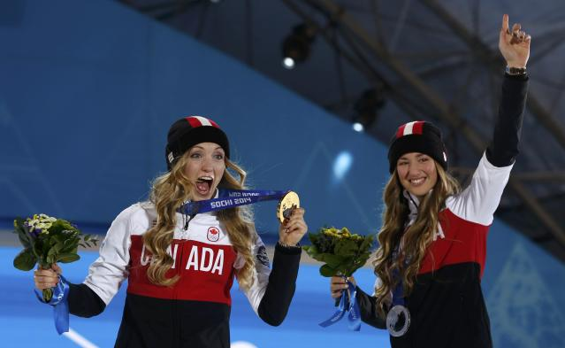 Gold medalist Justine Dufour-Lapointe of Canada celebrates with silver medalist, compatriot Chloe Dufour-Lapointe (R), during the medal ceremony for the women's freestyle skiing moguls at the Sochi 2014 Sochi Winter Olympics, February 9, 2014. REUTERS/Marko Djurica (RUSSIA - Tags: SPORT SKIING OLYMPICS)