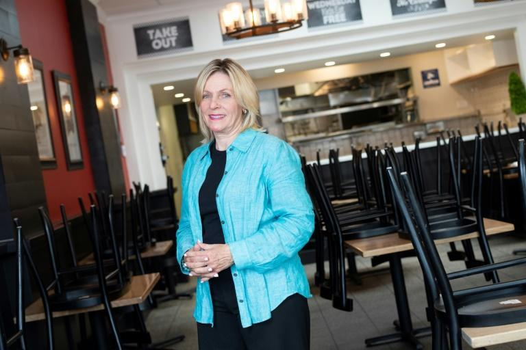 Madelyn Alfano owner of Maria's Italian Kitchen poses inside one of two restaurants she was forced to shut down because of the Covid-19 pandemic, on July 28, 2020, in Santa Monica, California
