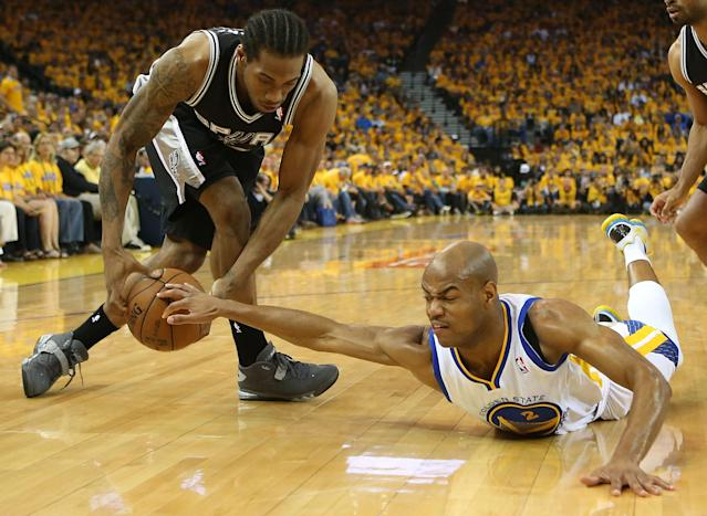 OAKLAND, CA - MAY 12: Jarrett Jack #2 of the Golden State Warriors battles with Kawhi Leonard #2 of the San Antonio Spurs in Game Four of the Western Conference Semifinals during the 2013 NBA Playoffs on May 12, 2013 at the Oracle Arena in Oakland, California. NOTE TO USER: User expressly acknowledges and agrees that, by downloading and or using this photograph, User is consenting to the terms and conditions of the Getty Images License Agreement. (Photo by Jed Jacobsohn/Getty Images)