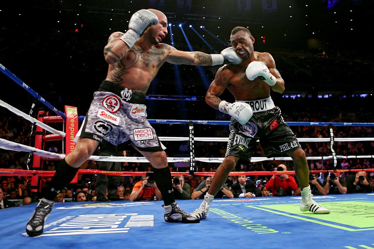 NEW YORK, NY - DECEMBER 01:  Miguel Cotto (L) connects on a punch while fighting against Austin Trout in their WBA Super Welterweight Championship title fight at Madison Square Garden on December 1, 2012 in New York City.  (Photo by Elsa/Getty Images)