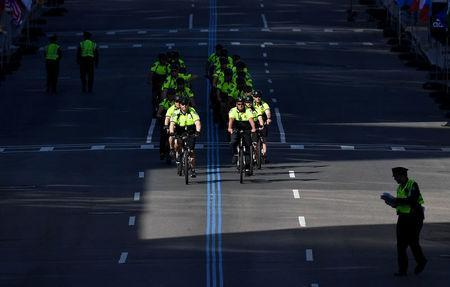 Boston Police officers on bicycles ride down the finish line. REUTERS/Gretchen Ertl