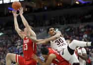 Missouri State's Tulio Da Silva (30) falls backward over Bradley's Dwayne Lautier-Ogunleye as Bradley's Luuk van Bree (13) reaches for the rebound during the first half of an NCAA college basketball game in the quarterfinal round of the Missouri Valley Conference tournament, Friday, March 8, 2019, in St. Louis. (AP Photo/Jeff Roberson)