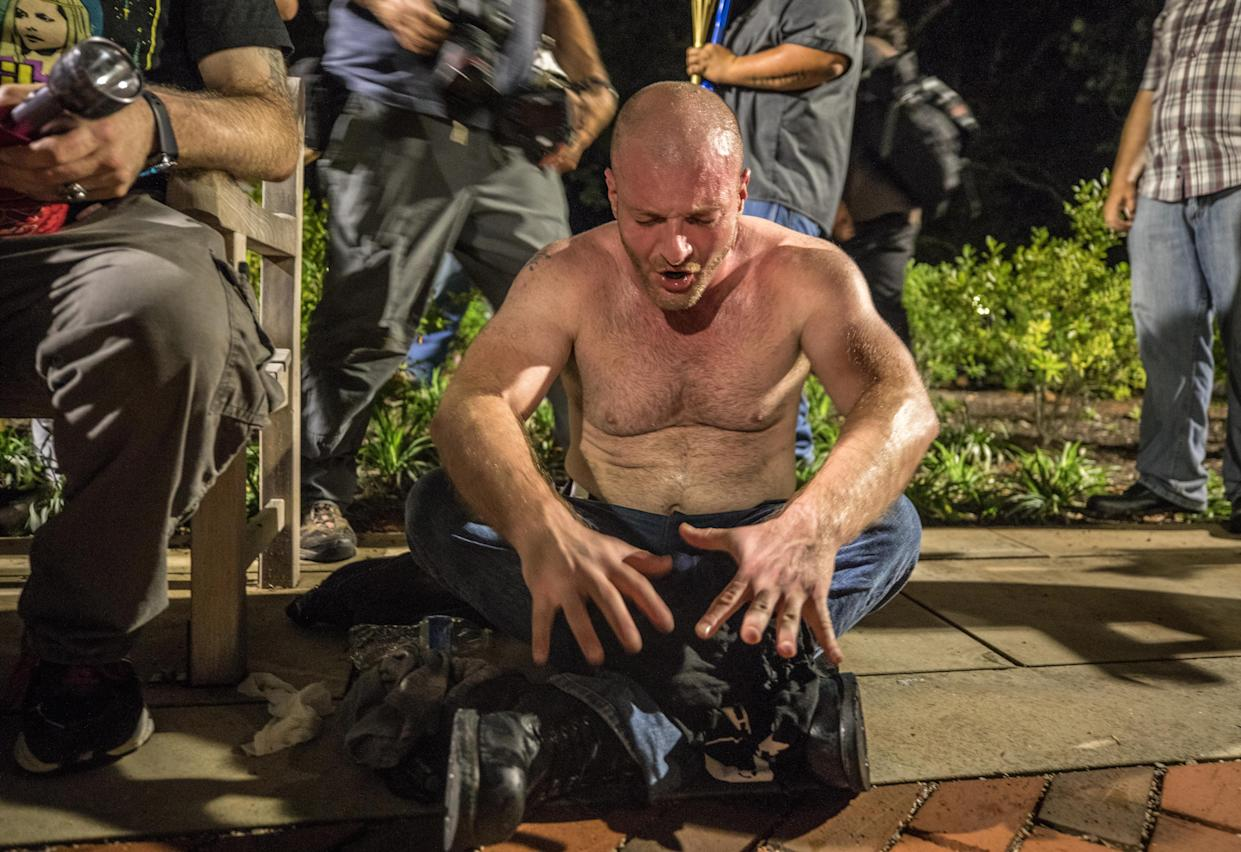 Christopher Cantwell, a white nationalist is overcome with tear gas after hundreds of white nationalists and white supremacists carrying torches marched in a parade through the University of Virginia campus on Aug. 11, 2017. (Photo: Evelyn Hockstein/For the Washington Post via Getty Images)