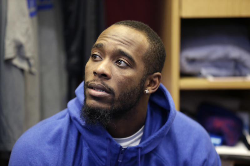 FILE - In this Jan. 5, 2017, file photo, New York Giants Dominique Rodgers-Cromartie talks to reporters in the locker room after NFL football practice in East Rutherford, N.J.  The Giants have suspended Rodgers-Cromartie, coach Ben McAdoo said Wednesday, Oct. 11, 2017. after practice without giving a reason. He said he had a meeting with 31-year-old on Tuesday night and Rodgers-Cromartie left the team on Wednesday. (AP Photo/Seth Wenig, File)