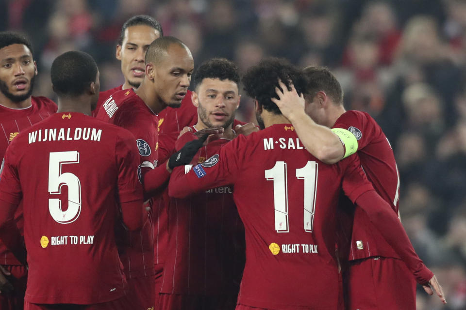 Liverpool's Alex Oxlade-Chamberlain, 3rd right, celebrates after scoring his side's second goal during the Champions League group E soccer match between Liverpool and Genk at Anfield Stadium, Liverpool, England, Tuesday, Nov. 5, 2019. (AP Photo/Jon Super)