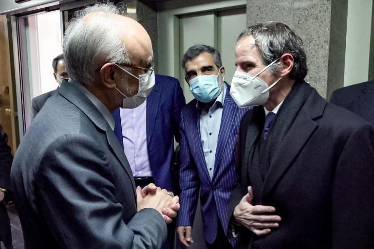 Head of the International Atomic Energy Agency Rafael Grossi, on the right, met the chief of the Atomic Energy Organisation of Iran, Ali Akbar Salehi, in Tehran