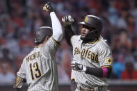 San Diego Padres' Fernando Tatis Jr. is congratulated by Manny Machado (13) after hitting two-run home run against the San Francisco Giants during the third inning of the second game of a baseball doubleheader Friday, Sept. 25, 2020, in San Francisco. (AP Photo/Tony Avelar)