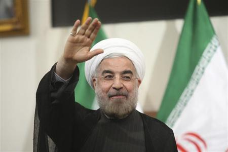 Iranian President-elect Hassan Rohani gestures to the media during a news conference in Tehran