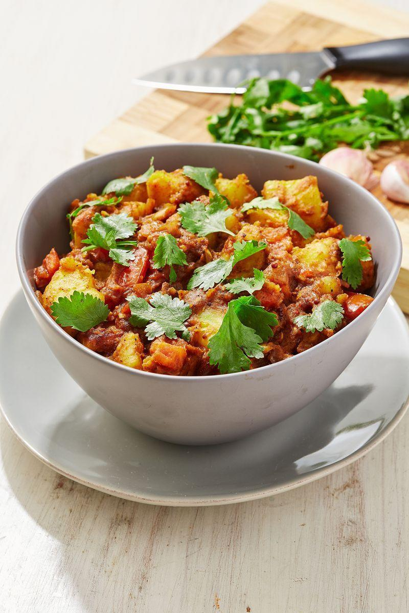 """<p>Bombay Potatoes or Bombay Aloo is a traditional Indian dish using potatoes as its main ingredient, that are boiled, fried and flavoured with a variety of spices. Often served as a side dish to a <a href=""""https://www.delish.com/uk/cooking/recipes/a29782603/sweet-potato-chickpea-curry/"""" rel=""""nofollow noopener"""" target=""""_blank"""" data-ylk=""""slk:curry"""" class=""""link rapid-noclick-resp"""">curry</a>, we also love eating Bombay Aloo on its own, or with <a href=""""https://www.delish.com/uk/cooking/recipes/a31183852/tarka-daal/"""" rel=""""nofollow noopener"""" target=""""_blank"""" data-ylk=""""slk:daal"""" class=""""link rapid-noclick-resp"""">daal</a>.</p><p>Get the <a href=""""https://www.delish.com/uk/cooking/recipes/a31189648/bombay-aloo/"""" rel=""""nofollow noopener"""" target=""""_blank"""" data-ylk=""""slk:Bombay Aloo"""" class=""""link rapid-noclick-resp"""">Bombay Aloo</a> recipe.</p>"""